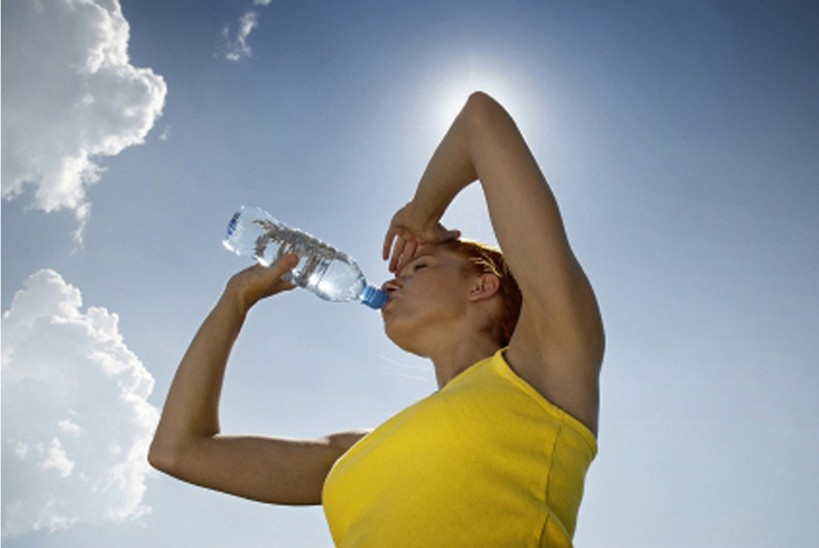 A woman drinking bottled water. Image is used for the article, 6 savvy tips to defy extreme cannabis high-smoking a high thc strain. The article is for Cannabis Twenty-Four Seven at http://420x247.com