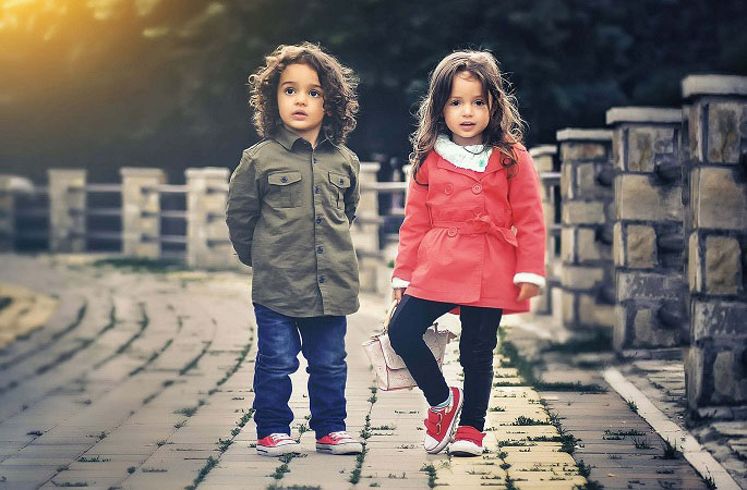 A Picture of 2 Kids Wearing Red Snickers - image for the article Is CBD Safe for Children