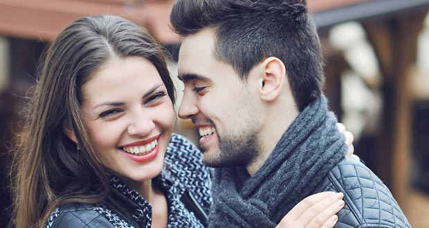 Couple laughing - 8 Ways Cannabis Can Improve Your Relationship